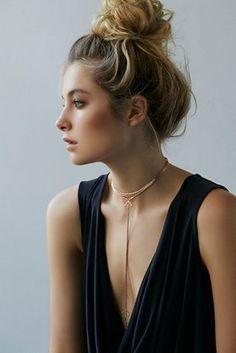 Add a chain choker with a low cut blouse.