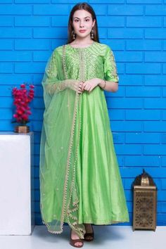Cast a spell with this bright green chanderi silk anarkali suit which will give a very sassy look. This round neck and elbow sleeved outfit accentuated with cutdana, pearl, and zardosi work. Available with chanderi silk churidar in bright green color with bright green net dupatta. Churidar is plain. Dupatta prettified with pearl lace. #anarkalisuit #usa #Indianwear #Indiandresses #andaazfashion