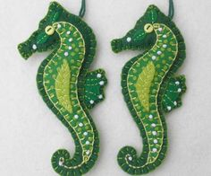 Colorful seahorse ornament, handmade from felt with applique and embroidered details, and a tiny button for the eye. For Christmas or any occasion. Approx 4.5 inches / 12cm high, with a cotton loop fo