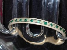Rare Small or Child's Celluloid Art Deco Rhinestone Bangle can be purchased at Bangles & Beads for $50.