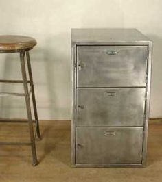 polished steel locker cabinet , inside army green...could do this to an old thrit find...Steel.  Exterior has been stripped, polished and clear coated.  Interior green paint is original.