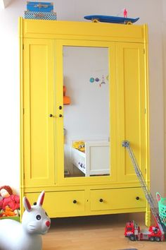 I have almost this same antique wardrobe...I love this!! (but might be too chicken to do this bright yellow!)