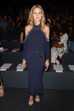 OP wears a gorgeous navy OTS maxi dress with a pleated skirt.