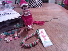 our little elf got busy digging through the cereal and made himself and my daughter matching red and green necklaces!