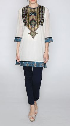 ivory embroidered cotton jute kurti  The designer kurti is adorned with an embroidered panel on the yoke and printed panels on the hem and the sleeves