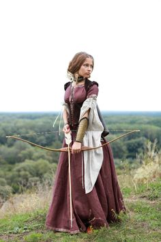 I imagine this is the daughter of a high offical in the kingdom. She is done with her royal life and is breaking free. She posies her crossbow ready to fight