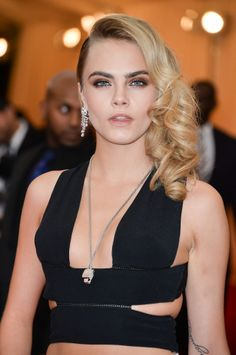 As one of the brave women to wear a crop top to the carpet, Cara Delevingne's was made up of multiple bands, keeping it super-sexy at the 2014 Met Gala.