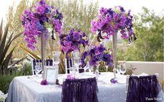 purple and fuchsia wedding centerpieces