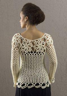 Blusa de manga comprida em crochê. Pontos largos e rosetas, integradas compõe a peça.
