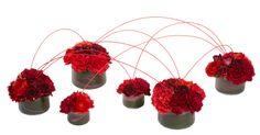 Midollino Sticks join smaller vases together for a composite arrangement