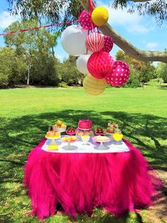 sunshine and lemonade party with custom table skirt and paper lanterns