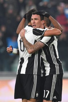 Mario Mandzukic (R) of Juventus FC celebrates his goal with team mate Sami Khedira (L) during the Serie A match between Juventus FC and Pescara Calcio at Juventus Stadium on November 19, 2016 in Turin, Italy.
