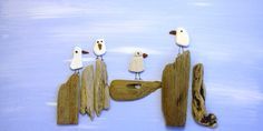 Seagulls made with sea pottery, sea glass and driftwood. ******