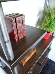 Bespoke industrial furniture from Charlton & Co.  Custom made wood and steel bookcase.