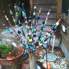 Garden art. Made from a whisk. Cut them in half and add the beads. Very easy an creative.