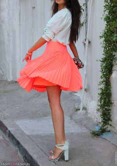 my orange skirt with a white blouse and a sequence clutch