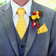 Gray bespoke suit by Indochino, a polka-dot tie and pocket square (from Gracey Bags), and a boutonniere of yellow tea roses. #weddings #grooms  Photo by Anne Robert Photography