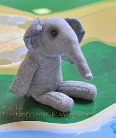 I need to find some grey socks so I can make this elephant sock stuffie!