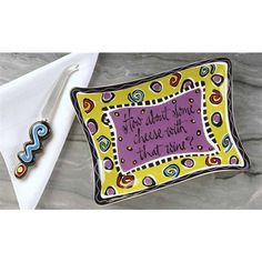 How About Some Cheese With That Wine? A Cheese platter with attitude, and its own cheese knife, who could ask for anything more? The colors are bright and whimsical with a fun flair.  Designed by Joyce Shelton. Joyce is a very talented artist who enjoys a varied career in commercial illustration... see more details at https://bestselleroutlets.com/home-kitchen/kitchen-dining/cutlery-knife-accessories/specialty-knives/product-review-for-cheese-platter-with-knife-and-attitude-j