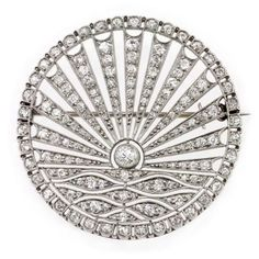 A diamond brooch portraying the sun rising over water; the rising sun is a symbol of hope. (Bentley & Skinner)
