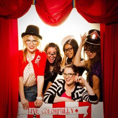 We could make this red curtain out of plastic tablecloth to frame the photo booth.