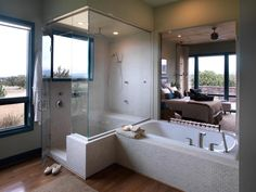 This master bathroom with a large walk-in shower is a charming escape and provides a relaxing oasis for the homeowners. The tile accents create a luxurious feel.