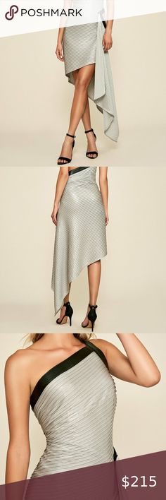 """NWOT TADASHI SHOJI PINTUCKED DRAPED EVENING DRESS This striking silver Roman-esque evening dress creates a curve-skimming silhouette as it wraps around the body, then releases in a fluid drape while black faux/vegan leather bands create bold accents for a dazzling look that is straight off the runway! It features a hidden side zip closure and is lined. Stretchy fabric. In excellent condition!  Size S (See measurements for sizing also).  Measurements:  35""""-36"""" Bust  27.5""""-28.5"""" Waist  38""""-39""""… Tadashi Shoji, Dress First, Vegan Leather, Evening Dresses, Runway, Wraps, Womens Fashion, Things To Sell, Black"""