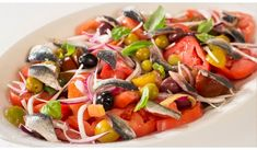 Ensalada de tomate con sardina confitada