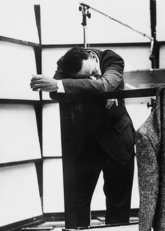An exhausted Frank Sinatra rests his head on his arms in a recording studio after five hours of continuous singing. March 1967.