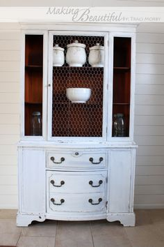 DIY:: Beautiful  Ironstone Hutch- I love the idea of using chicken wire in the door, would be great fix for all of those Goodwill finds that have missing and broken glass!!