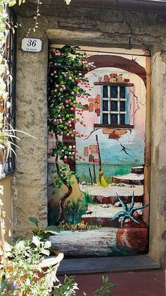Ism't this trompe l'oeil door just amazing?! A hand painted door in Valloria, Italy, a small city where artists have painted all the residential doors into unique and beautiful works of art!