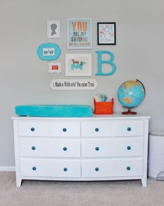 Project Nursery - Gray Striped Orange and Aqua Nursery Changer and Gallery Wall