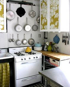 Putting up a pegboard as a stylish + functional backsplash is the best way to store your pots + pans.
