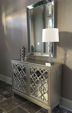 """Mirror, mirror, on the wall."" Just one gorgeous wall mirror can enhance and add depth to even the smallest of spaces, but layering in even more mirrored elements (like our Anderson Cabinet) takes luxe to the next level. Photo submitted by Living Room Decor, Bedroom Decor, Bedroom Ideas, Dining Room, Living Room Sets, Stylish Home Decor, Entryway Decor, Entryway Bench, Entryway Mirror"