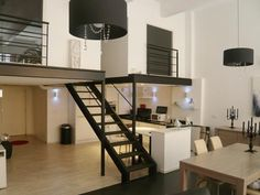 Raises the concept of creating urban spaces in a double height great room (The loft Baldwin and Isabella in Roubaix) Apartment Therapy, Apartment Design, Apartment Living, Lofts, Mezzanine Design, Loft Paris, Warehouse Living, Loft Studio, Great Rooms