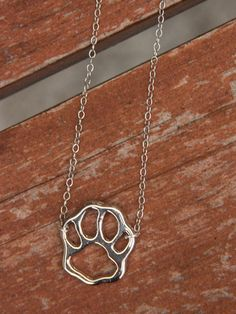 Puppy Honey - Silver Paw necklace Just found this site with so many cute dog lover apparel!