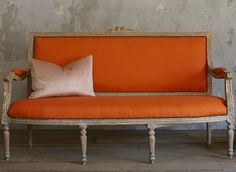 Fantastic Louis XVI style vintage settee in pickled gold gilt and Gustavian Grey finish, with bright tangerine canvas upholstery.
