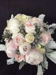 A nice winter bouquet with brunia berries, peonys in white and pink. Garden roses in pink, white ranunculus