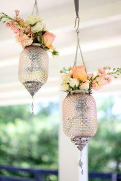 flowers in hanging glass lanternshttp://pinterest.com/all/?category=wedding_events#
