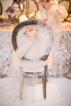 wedding chair decor with tulle and pearls and flowers