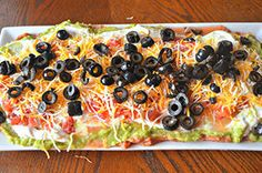 VELVEETA, sour cream and guacamole bring the cheesy, creamy deliciousness to this easy Mexican-style 7-layer dip.