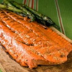 Alaskan BBQ Salmon  	    Share                  Ingredients 1 cup brown sugar 1/2 cup honey 1 dash liquid smoke flavoring 1/2 cup apple cider vinegar 1 (4 pound) whole salmon fillet Directions Preheat grill for high heat.
