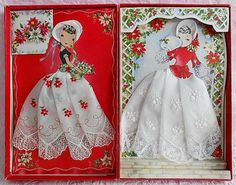 Paper doll hankies in display box.  These handkerchiefs are embroidered and form the dress.