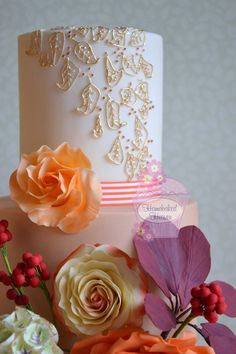 """#Wedding #cake decorated with oversized #rose in burnt #orange, """"Double Delight"""" hybrid tea rose, #cotinus foliage, #scabiosa #seed heads, #callalilies and #berries... plus leaves in #gilded royal icing piping for a touch of #opulence... a riot of #autumnal colour...."""