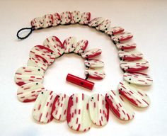 """Erica Rosenfeld, """"Red and White Lined Necklace""""  2008. Glass and fishing line 17 inches long."""