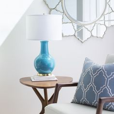 Proper lighting never goes out of style! Lamp (SAY-203), pillow (BA-049) and mirror (RWD-6001) by Surya.