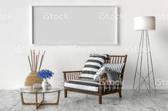 Solo chair and blank picture frame background royalty free stockfoto