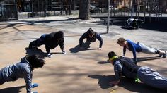 Group push-ups ladders at the park with the Bar-barians class (http://www.bar-barians.com/Bar-barian-Group-Training.html) .