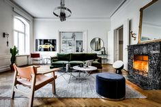 The timeless pairing of old and new is impeccably displayed in the Styrmansgatan Apartment. Housed in a 19th-century building, the Stockholm residence's historic character shines through in the intricate moldings, arched windows, and herringbone wood floors. These vintage elements create...
