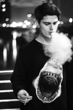 cigarette smoke smoking young guy male boy fair hair pullover shark